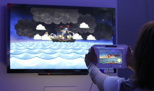 An assistant demonstrates the use of the new Nintendo Wii U controller during the Electronic Entertainment Expo, or E3, in Los Angeles